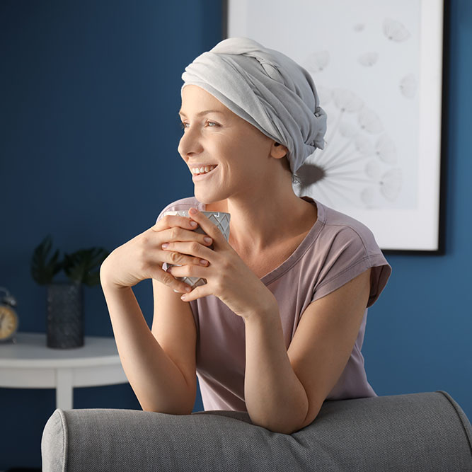 Depiction of happy woman after chemotherapy drinking kratom tea