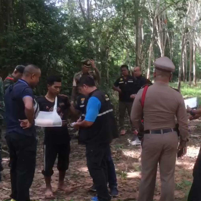 One of the three wounded kratom smugglers on Tuesday points out the gang's escape route into Thailand, in Sadao district, after the early morning shootout that left one Malaysian policeman dead and another wounded.