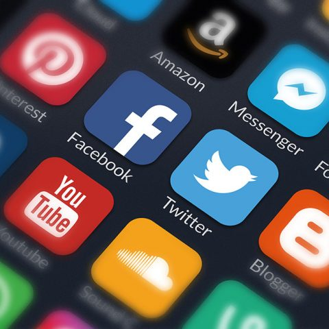 Zoomed in shot of a list of social media apps on a smartphone